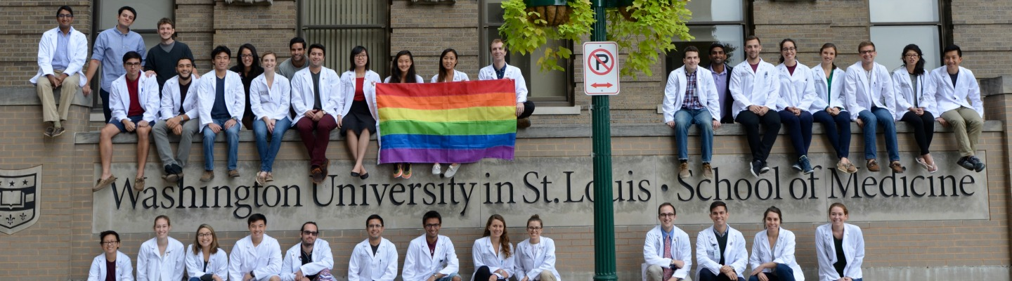 WashU medical students holding a rainbow flag in support of LGBTQ+ health and wellbeing